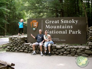 The family in front of the Great Smoky Mountains Sign - I am thinking Christmas Card this year.