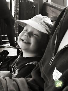 Very happy Booga on a train