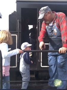 The engineer invited him up the steps.  Booga wanted to go inside the train and drive.  They were dress similar.