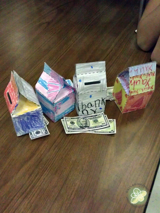 My troops milk carton banks and their fake money.