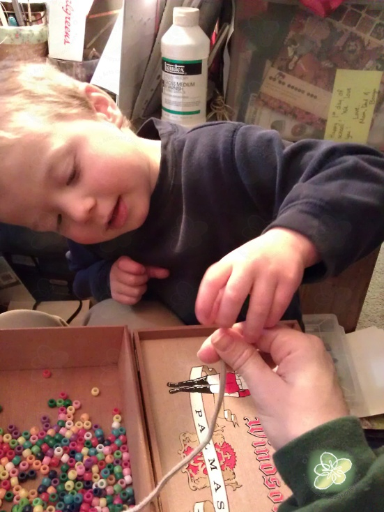 Booga stringing the bead