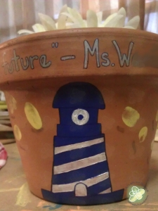 Teacher's Gift - this year it was a Terra Cotta Pot with the school logo and the kids finger prints as the rays of light from the lighthouse.  Due to the Tropical Storm the flowers were not from the garden, we made flower pens.