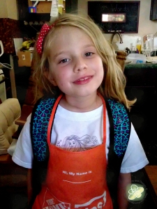 Showing off her backpack in the midst of our home renovations (note the Home Depot Apron).