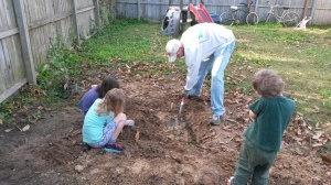 Giant patch of dirt in backyard - Hey honey let us build a fire pit.